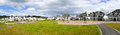 Neighborhood panorama luxury with white houses and cloudy sky Royalty Free Stock Photo