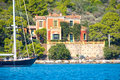 Neoclassical villa architecture by the sea on an island in greece Stock Photos