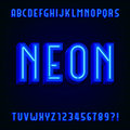 Neon alphabet vector font. 3D type letters with blue neon tubes and shadows. Royalty Free Stock Photo