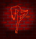Neon girl image on a brick wall dancing striptease vector illustration Royalty Free Stock Photos