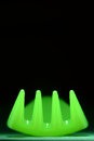 Neon green fork on black abstract bright plastic tines design Royalty Free Stock Image
