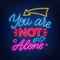 Neon lettering you`re not alone. Motivational quote.