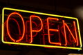 Neon open sign a red and yellow that says Royalty Free Stock Photos