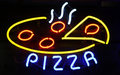 Neon Pizza Sign on Black Stock Images