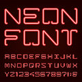 Neon red light alphabet vector font techno style tube letters on dark background type letters numbers and punctuation marks Royalty Free Stock Photo