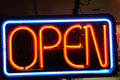 Neon shining signboard with word open night Stock Photos