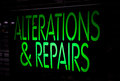 Neon sign alternation and repairs on black background Royalty Free Stock Photography
