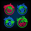Neon signs. The set of different bright signboard with fruit.