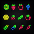Neon signs. The symbols of different fruit and vegetables. Royalty Free Stock Photo