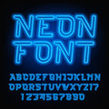 Neon tube alphabet font. Blue color oblique type letters and numbers.