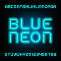 Neon tube alphabet font. Type letters and numbers. Blue color on a dark background.