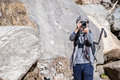 Nepal - 31 December 2016 :: photographer on the way hiking to Hi Royalty Free Stock Photo