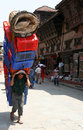 Nepalese man carrying heavy load on the street in kathmandu in nepal Royalty Free Stock Images