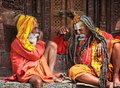 Nepalese sages kathmandu central city square durbar two conversing on a seemingly important subject or maybe not Royalty Free Stock Images