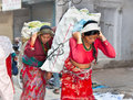 Nepalese women carry things in the traditional way in kathmandu nepal Royalty Free Stock Images