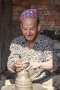 Nepali man enjoying his pottery work Royalty Free Stock Photo