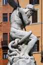Neptune fighting octopus the basin part of the fontana del nettuno was designed in by giacomo della porta and was completed in by Stock Image