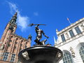 Neptune fountain and city hall in gdansk poland of the artus court the main town Royalty Free Stock Image