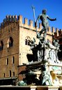 Neptune Fountain illuminated by the morning sun in the city center in Bologna in Emilia Romagna (Italy) Royalty Free Stock Photo