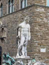The Neptune fountain and Palazzo Vecchio in Florence, Italy . Detail of the Neptune statue . Royalty Free Stock Photo