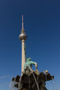 Neptune fountain and television tower in Berlin Royalty Free Stock Photo
