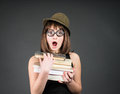 Nerd girl studying. Education. Student in funny glasses with books on grey. Royalty Free Stock Photo