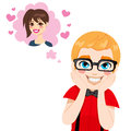 Nerd guy in love with glasses and dental braces thinking about the beautiful brunette girl of his dreams Stock Photos