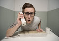 Nerd guy on the phone vintage talking and typing Stock Images