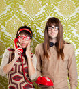 Nerd humor couple talking vintage red phone Stock Photography