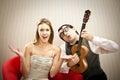 Nerd man boyfriend play ukulele love song for his girlfriend for valentine day