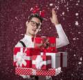 Nerd man with gifts grimacing stack of christmas presents Stock Photos