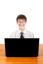 Nerd student with laptop happy at the desk isolated on the white background Royalty Free Stock Image