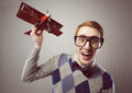 Nerd student playing tin airplane Royalty Free Stock Images