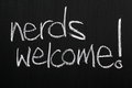 Nerds welcome the phrase written in white chalk on a used blackboard Royalty Free Stock Photos
