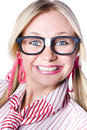 Nerdy brainy businesswoman wearing stereotypical dorky glasses looking confident with a cheeky exuberant grin Royalty Free Stock Photography