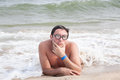 Nerdy guy on the beach geek in glasses posing with duckface and selective focus Royalty Free Stock Photos