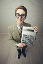 A nerdy guy with a calculator Stock Image