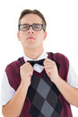 Nerdy hipster fixing his bow tie Royalty Free Stock Photo
