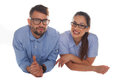 Nerdy looking couple looking at camera Royalty Free Stock Photo