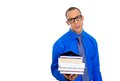 Nerdy man holding books closeup of a young wearing big black glasses anxious in anticipation of finals exam test isolated on white Royalty Free Stock Photography