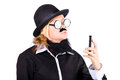 Nerdy woman disguised as businessman in hat with slim mobile telephone white background Stock Photos