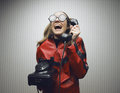 Nerdy woman speaking on a black rotary vintage phone funny nerd humor talking retro telephone wallpaper Royalty Free Stock Photos
