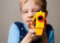 Nerf gun child shooting a at the viewer the barrel is pointed at the camera so you can imagine being shot by this not so Royalty Free Stock Photo