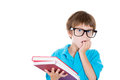 Nervous anxious young boy biting fingernails closeup portrait of in big black glasses carrying books looking sideways while Stock Photography