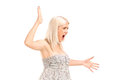 Nervous blond female shouting Stock Photo