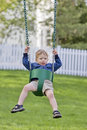 Nervous boy on swing Royalty Free Stock Images