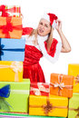 Nervous christmas woman with presents many isolated on white background Stock Images