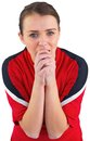 Nervous football fan in red on white Royalty Free Stock Photos
