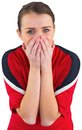 Nervous football fan in red on white Royalty Free Stock Image