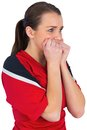 Nervous football fan in red on white Stock Image